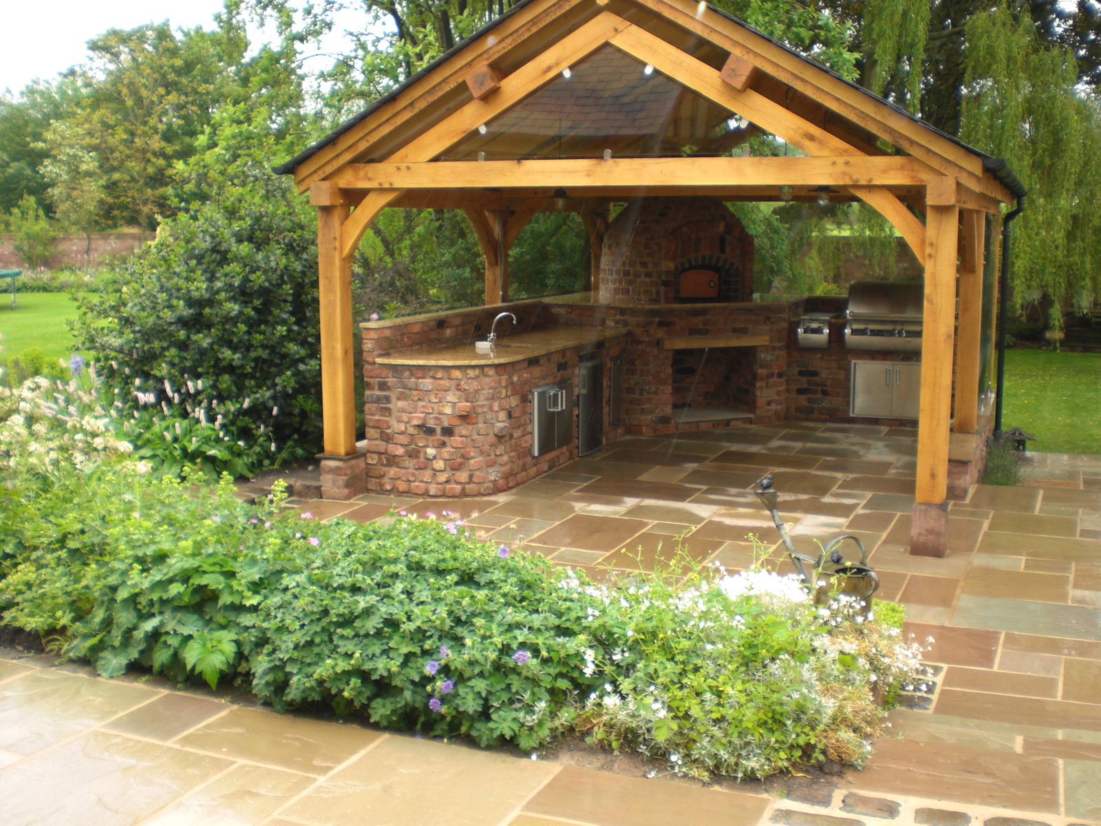 Our blog the lapa company siting bbqs under shelters for Small garden shelter